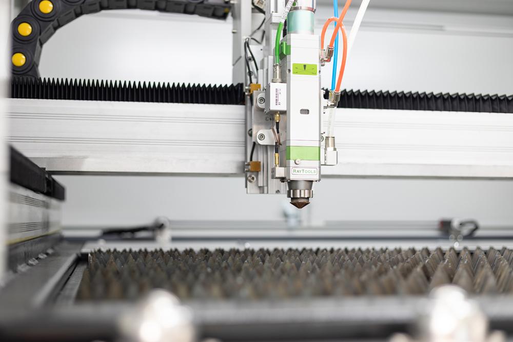 Laser head close-up MetaQuip FC1390 metal laser cutter